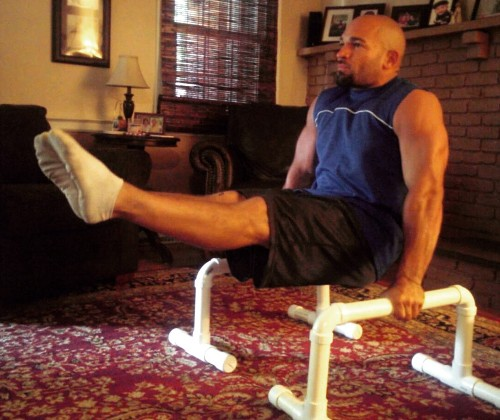 L-sit on PVC parallettes